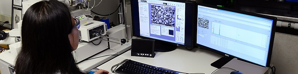 woman looking at her desktop in a laboratory